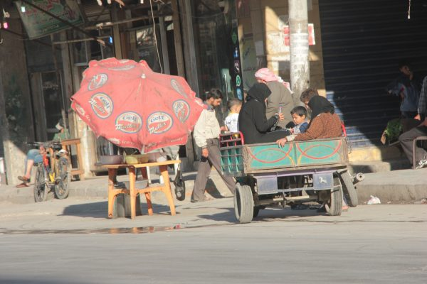 Private transportation for a whole family in the al-Maadi neighbourhood of Aleppo. Photo by: Salah al-Ashqar
