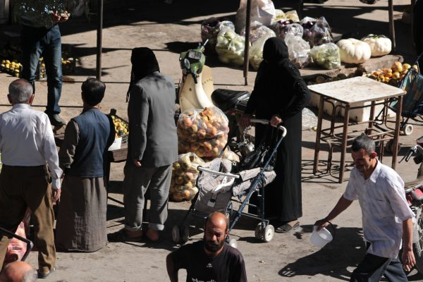 A woman from the Idlib countryside shopping in the main market. Photo by : IWPR