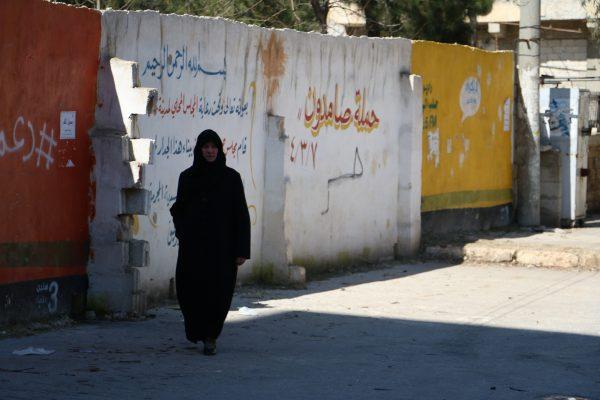 A woman walking through the Salah al-Din neighbourhood .