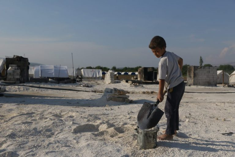 Displaced People Rebuild Their Camp