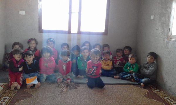 Children in the makeshift kindergarten in Hass. Photo: Jud Mustafa