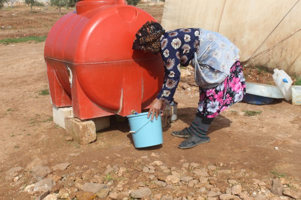 People store water in plastic tanks due to shortages and high prices currently being charged.