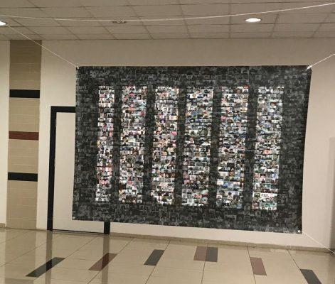 لوحة الرسامة فاطمة قونيلي وتظهر وجوه المعتقلين والمفقودين السوريين تصوير أمجد حسينو